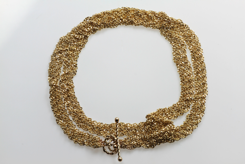 Zigt gouden vlecht armband