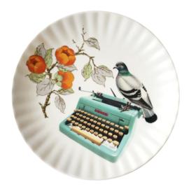 Bord typemachine met duif
