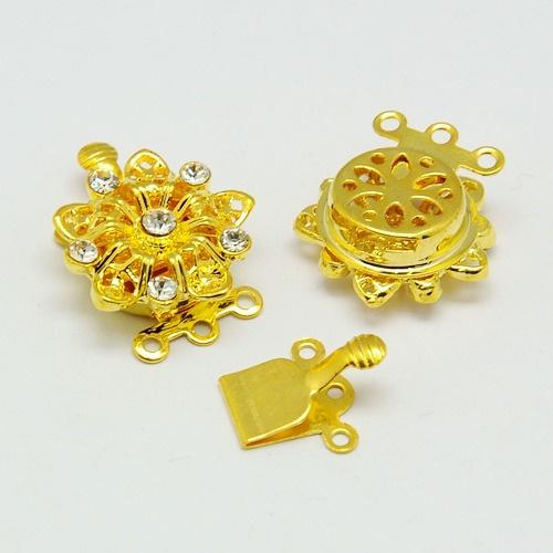Box slot goudkleur bloem met strass