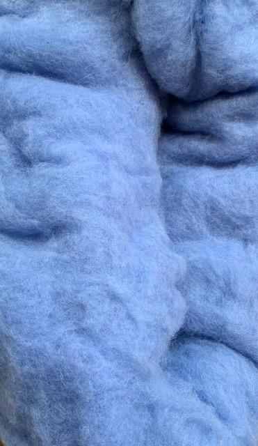 Bergschaap in vlies, hemels blauw