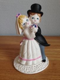 huwelijk koppel taarttopper met voetstuk