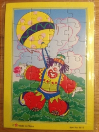 puzzel type clown met ballon