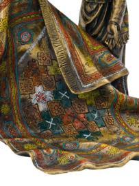 Arabische Oosterse tapijtenverkoper