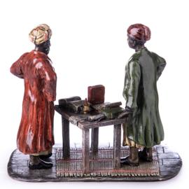 Arabische boekenverkoper brons beeld