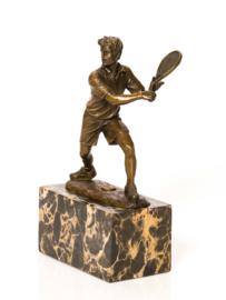 Bronzen tennisspeler backhand beeld