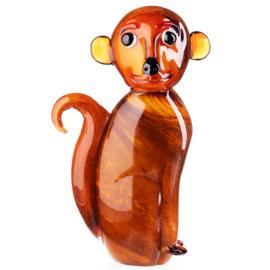 Zittende glazen aap