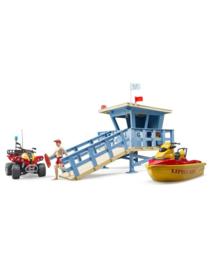 Strandwachttoren, jetski, quad en poppetje