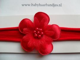 Voor de allerkleinste rood nylon haarbandje met bloem