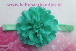 Smalle groen/goud gestippeld baby haarbandje met kanten bloem.