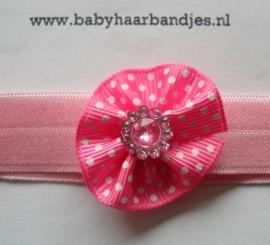 Voor de allerkleinste roze haarbandje met rozetje.