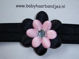 Smalle zwarte babyhaarband met zwart/roze bloem.