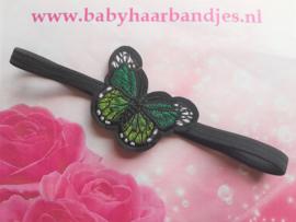 Smalle zwarte baby haarband met groene vlinder.