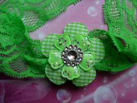 Kanten groene baby haarband met bloem.