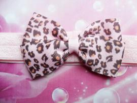Smalle roze baby haarband met print strikje.