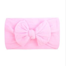 Super zachte roze nylon baby haarband met  strikje .