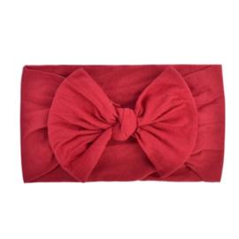Super zachte donker rode nylon baby haarband met strikje.