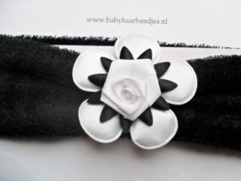 Brede zwarte baby haarband met bloem.