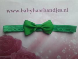 Smalle groene baby haarband met klein strikje 7 cm.
