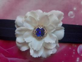 Smalle donke blauwe baby haarband met bloem.