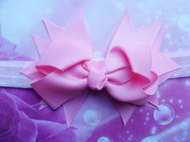 Smal roze baby haarbandje met  strik.
