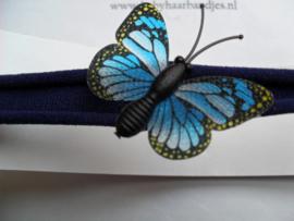 Voor de allerkleinste blauw nylon haarbandje met vlindertje.
