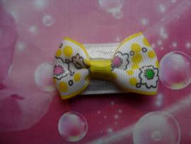 Baby haar knipje geel gebloemd strikje.
