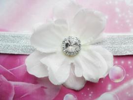 Smalle witte glitter baby haarband met bloem en stras.