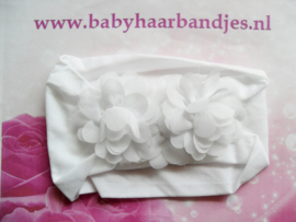 Witte nylon baby haarband met 3 toefjes .
