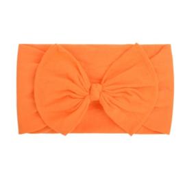 Super zachte oranje nylon baby haarband met strikje.