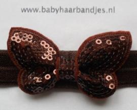 Voor de allerkleinste bruin haarbandje met glitter vlindertje.