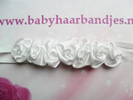Super smal wit baby haarbandje met roosjes.
