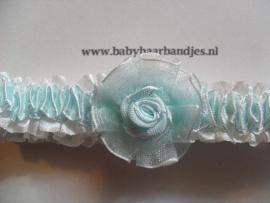 Voor de allerkleinste blauw roezel haarbandje met roosje.