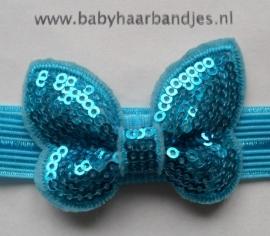 Voor de allerkleinste aqua blauw haarbandje met glitter vlindertje.