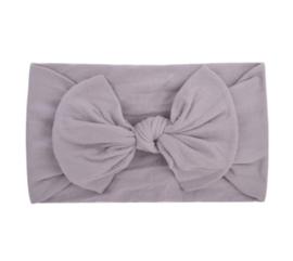 Super zachte grijze nylon baby haarband met strikje.