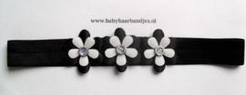 Smalle zwarte baby haarband met bloemetjes.