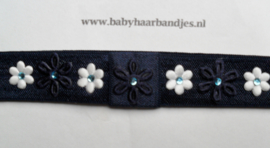 Smalle donker blauwe baby haarband met mini bloemetjes.