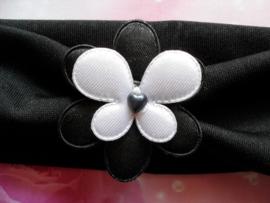 Brede  zwarte baby haarband met bloemetje en vlinder.