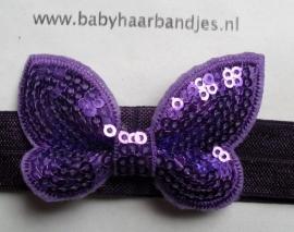 Voor de allerkleinste paars haarbandje met glitter vlindertje.