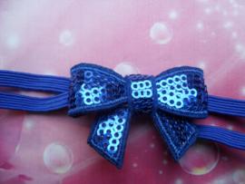 Super smal  blauw baby haarbandje met glitter strikje.