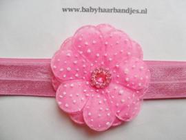 Smalle donker roze baby haarband met bloem.
