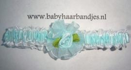 Voor de allerkleinste blauwe roezelhaarband met roosje.