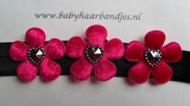 Smalle zwarte baby haarband met fuchsia bloemetjes en hartjes.
