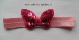 voor de allerkleinste roze haarbandje met fuchsia glitter vlindertje.