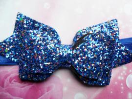 Smalle blauwe baby haarband met glitter strik.
