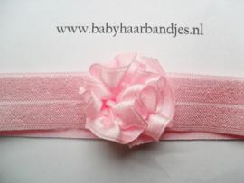 Voor de allerkleinste roze haarbandje met toefje.