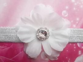 Smalle wit/zilveren baby haarband met bloem en strass.