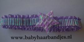 Voor de allerkleinste paars roezel haarbandje met sterretje.
