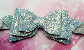 Smalle grijze baby haarband met glitter strik.