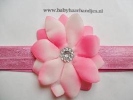 Smalle donker roze baby haarband met puntbloem.