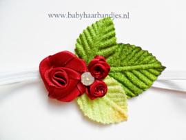 Super smal wit baby haarbandje met rode roosjes.